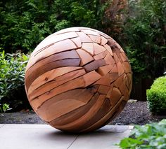 Shattered Sphere, 2011, reclaimed wood, by Brent Comber