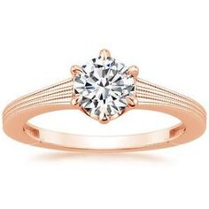 Beautiful rose gold band and diamond engagement ring