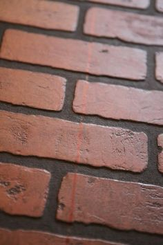 Plain walls are transformed in to stone walls with joint for Faux brick edging