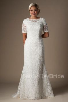 The Moira | This darling lace modest gown features an illusion bateau neckline and illusion lace half sleeves, complimented by a gentle mermaid silhouette and scalloped edging.     Gown available in Ivory or White    *Gown pictured in Ivory    Sleeve length or neckline can be customized.  Please call for more information.    Available at LatterDayBride.com or in Store Located in Salt Lake City, Utah