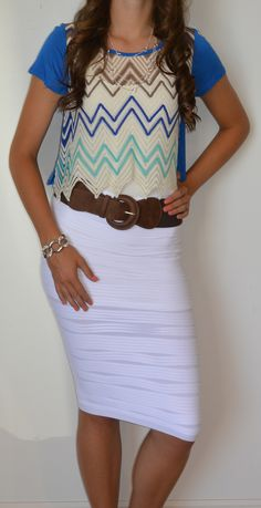 Cute top with white skirt and the jewelry goes perfect. Perfect outfit for a day out with friends. :)