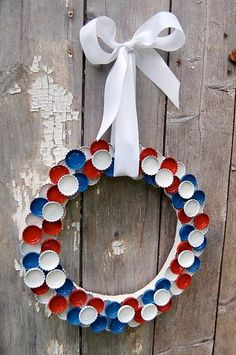 Red, white and blue wreath made of painted bottle caps - hang one or more on fence or deck for July 4 party.
