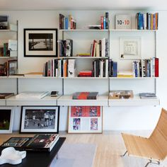 Storage for the living room, incorporating books, objects and picture frames.