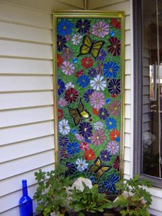 Clever use of an old shower door. Stain glass pieces glued and grouted with a light placed behind to show off at night.