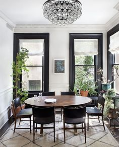 Black around the windows looks great. Maybe use black curtains in the dining room
