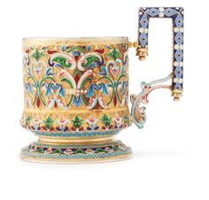 A Russian gilded silver and cloisonné and shaded enamel tea glass holder, Ivan Saltykov, Moscow, circa 1890, enameled with profuse polychrome foliate and geometric ornament.