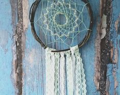 Beige Gray White Dream Catcher, Crochet Doily Dreamcatcher, medium dreamcatcher, crochet doily dream catcher, boho style, wedding decor, wall hanging, wall decor, handmade dreamcatcher.  SIZE:  - diameter of the hoop:-6,4 ( 16cm ) - height : 18 ( 45cm)  MATERIAL: - gray white crochet doily - cotton thread - wooden frame - wooden beads - feathers ~~ ***Note! Beads and feathers may vary from shown in the product pictures.   You can serve as original and magical souvenir for you friends. Each…