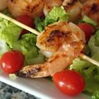 Sweet and Spicy Grilled Shrimp Recipe-1/2 c honey 1/2 c chile-garlic sauce 1 # med shrimp, peeled & deveined Soak 6 bamboo skewers in   H2O for 20 min Grill med heat & baste 10 min max