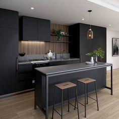 Nothing but love for this space.....and that island bench!  Stunning moody and Industrial style Kitchen by FRAME Apartments, designed by @hayball_arch #kitchendesign#cabinetrydesign#caesarstone#love#kitchen#timberfloors#interiordesign#interiordecor#interiorinspo#interior#interiordesigner#cabinetry