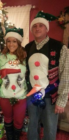 Mr. & Mrs. Snowman.  Ugly Christmas sweater.I cut white felt circles, I used adhesive spray to put circles & puff balls on sweatshirt. Safety Pins for the bulbs & used   Double stick Velcro for eyes (battery operated tealight candles :) Hubbys nose is a Styrofoam cone wrapped in orange felt. I safety pinned the orange felt to sweatshirt :)
