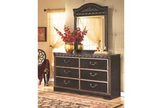 Coal Creek dresser looks like it's fit for a king. Faux marble top and durable engineered wood make it affordable enough for even us commoners. Replicated dry-brush finish provides a bit of sparkle while the ornate drawer handles and egg-and-dart moulding prove that beauty is in the details.