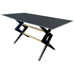 Ico Parisi Attributed Desk with Scissor Style Base in Black Lacquered Wood | From a unique collection of antique and modern desks and writing tables at https://www.1stdibs.com/furniture/tables/desks-writing-tables/