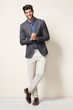 CASUAL WITH A TWIST The blazer and pants are conventional, but a print shirt adds a little personality.