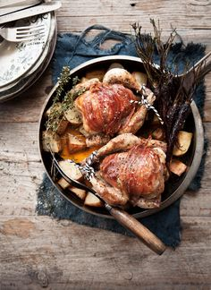 Pancetta and thyme poussins with roasted vegetable broth