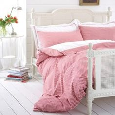 Beginning to sense and love white - white floors and walls, with colour only in the bed linen..