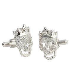 He thinks he deserves to be treated like a king.. Treigh's skull cufflinks