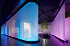 on a luminous fabric membrane there is an interaction of differently shining colour hues and visual moods to which sound installations were added in order to slowly spread the effect of the single light atmospheres into the whole Philips brand space.