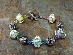 Lampwork beade bracelet in blue pink purple by thepinkmartini, $70.00