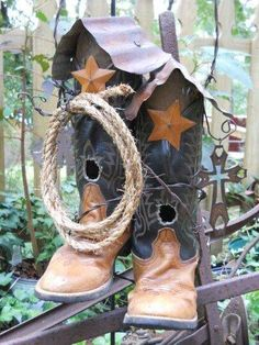 Have an old pair of boots? This picture showed up from C-A-L Ranch Stores and it's so simple. Take a piece of rusty metal and bend it into a roof and add a rusty or tin sar to the front. Cut a hol for a 'door' about 1 to 1 1/2 inch round.