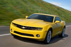 I usually don't like yellow cars.but the Camaro pulls it off nicely Classic Chevrolet, Chevrolet Cruze, Chevrolet Camaro, Cars Under 25000, Auto Body Repair Shops, Chevy Vehicles, Car Tent, Transformers Cars, Car Finder