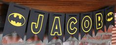This Batman banner features a personalized name on black pennants with yellow and black letters with two cut outs of the Batman logo. Perfect for a birthday party! Please note that the ribbon used to hang the banner is not included with this listing. Each pennant measures about 7.25 inches wide and 10.25 inches tall. This banner makes a statement! It is considerably larger than most banners out there. Please note ribbon is not included with the banner. I can customize the name on the banner…