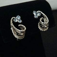 VINTAGE Amy Lee Sterling & Blue Stone Earrings These beautiful filigree earrings are solid silver and set with light blue stones which look like topaz. They are stamped Amy Lee Sterling on the screw backs. Beautiful vintage bling in perfect condition. Vintage Jewelry Earrings
