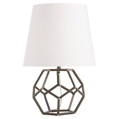 Multiple natural iron pentagons are created when hammered square barstock is joined together with brass welds. This throughly geometric yet organic lamp is topped with a tapered shade of white microfiber lined in the same material.