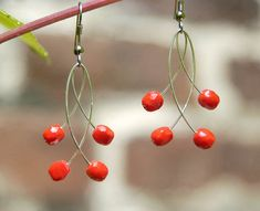 I handmade these contemporary earrings of vivid coral red Czech glass and silver plated wire. They are very elegant, stylish and will go well with bright summer dresses. My red coral earrings will add color to any business casual outfit and office s enjoy the feel and confidence boost a nice set