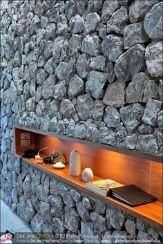 Inset display shelf in rock wall with downlighting. Iconic stone walls at X2 Kui Buri resort Thailand