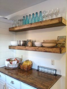 10 Genius Kitchen Upgrades You Can Actually Afford // Put up inexpensive shelves for bulky items