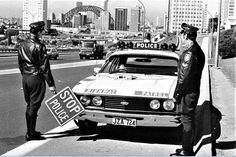 Highway Patrol officers (New South Wales Australia) standing next to their Ford Falcon patrol car Sydney (Note Sydney Harbour Bridge in the background) Sacramento, Brooklyn, Georgia, Australian Cars, Australian Vintage, Atlanta, Aussie Muscle Cars, Ford Classic Cars, Classic Bikes