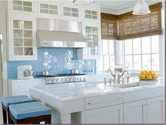 Woven Wood Shades and that blue backsplash!