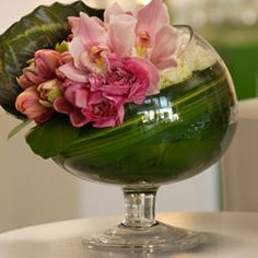 different flowers but I love the greenery draped inside the glass!