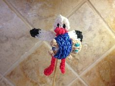 Rainbow Loom STORK figure. Designed and loomed by Cheryl Spinelli at Looming WithCheryl. Click photo for YouTube tutorial. 04/17/14.