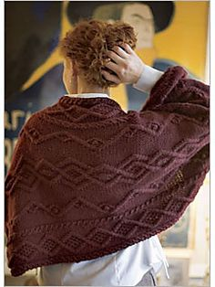 "Pattern Description from Interweave Knits, Fall 2005: ""A little more than a shawl but a little less than a sweater, Shirley Paden's shrug is a simple rectangle with cuffs. Of course, a luxurious cashmere-silk yarn worked in an intricate diamond-cable pattern makes it anything but ordinary. The shrug can be worn as shown, or take your arms out of the sleeves and throw it on as an encompassing shawl or wrap."""