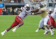 South Carolina defensive end Jadeveon Clowney makes a move to get around Central Florida tight end Justin Tukes in Orlando Saturday. (John Raoux/AP)