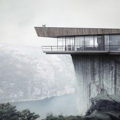 Grey | Contemporary concrete and glass home on a cliff in fog