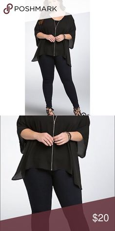 "Torrid Black Zip Up Chiffon Blouse Like New, black Torrid zip up Blouse. Can be worn completely zipped up, or unzipped like a cardigan.   Model is 5'9.5"", size 1  * Size 1 measures 29 1/4"" from shoulder * Polyester and cotton * Wash cold, dry low * Imported plus size top   ➡️No Trades. ➡️No Lowball Offers. ➡️No Holds. ➡️Bundle and save! torrid Tops Blouses"