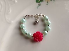 A personal favorite from my Etsy shop https://www.etsy.com/listing/294284687/girls-glass-pearls-and-rose-bracelet