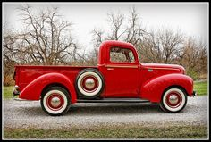 Normally I hate the color red for cars, but THIS time -- perfect! Would love to be driving this around!