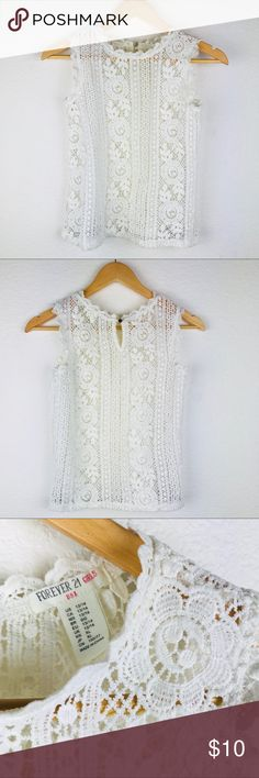 """FOREVER 21 Lace Top Size 13/14 Girls This is beautifully made  in size 13/14 girls . It's ivory colored, studio lights make it look white .  Perfect conditions. I picked it up because it was too cute to leave behind ☺️ Length 18"""" Shoulder to Shoulder 12"""" Pit to Pit 15"""" No Trading or Modeling ::161 Shirts & Tops Tank Tops"""