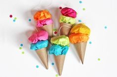Ice cream cones made from bright tissue and brown craft paper, with a string to hang them up. One of everybody's favorite dairy products is ice cream, after all!