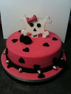 Girly skull and crossbones cake by Kerry's cakes