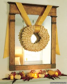 Martha Stewart Harvest Wreath: It may be too soon for boughs of holly, but now is just the moment for a crisp-as-fall wreath made with artfully layered dried cornhusks. We hung ours over an antique mirror using golden satin ribbon, secured at the top with tacks Small gourds, interspersed with candles and berries, complete the display.  Harvest Wreath How-To:   You'll need four to five 8-ounce bags of dried cornhusks to cover an 18-inch straw wreath form. (Husks are inexpensive and available at crafts stores and Mexican food shops.) Soak husks in water until pliable, about 10 minutes, and tear into 2-inch-wide strips. Bend 1 strip in half, and attach to wreath form with a U pin. Working from the inside of the wreath form outward, create rows of 4 or 5 strips. Circle the wreath form as you go, overlapping rows so pinned edges stay hidden.