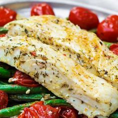 Halibut fillet with green beans and cherry tomatoes baked in a delicious Mediterranean sauce of garlic, olive oil and lemon juice. Comes together in less than 30 mins! See the step-by-step on The Mediterranean Dish. Fish Recipes Healthy Tilapia, Easy Fish Recipes, Salmon Recipes, Seafood Recipes, Cooking Recipes, Baked Halibut Recipes, Healthy Sauces, Cooking Ideas, Dinner Recipes