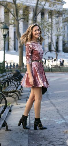 Pink crushed velvet u-back fit and flare skater dress perfect for fall and winter bridal showers with black ankle sock booties with gold buckle and black and gold waist belt