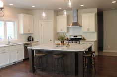 white kitchen with stained island and white granite