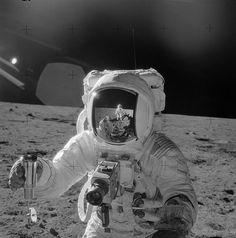 Alan Bean holding a vacuum-sealed lunar soil sample contai… | Flickr