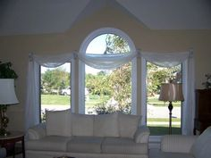 Throw sway with Kirsch swagholders...simple and easy to showcase the beauty of the window...
