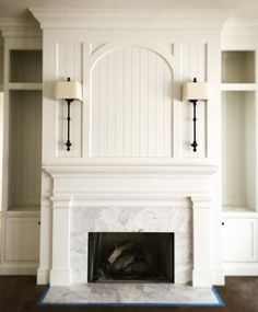 Love the arch and sconces. Would do brick instead of marble surround